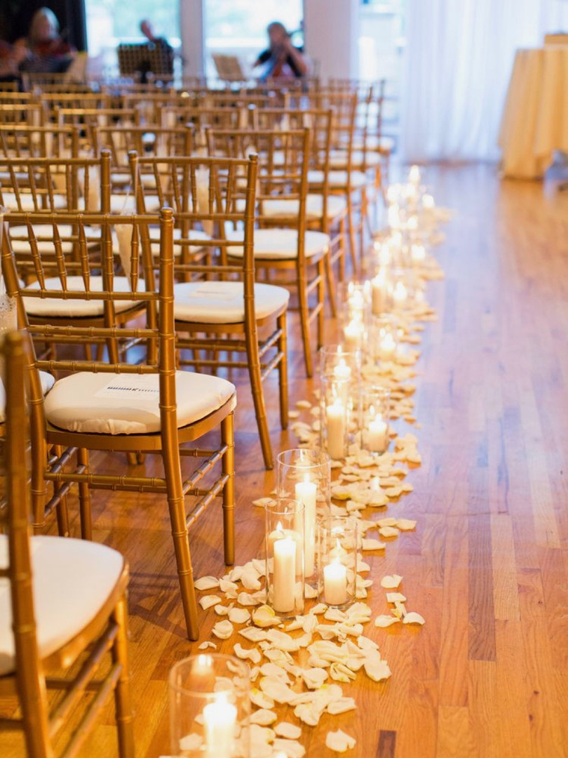 Aisle candles and rose petals