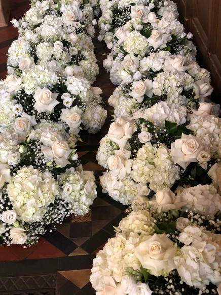Whites and cream table centres at St Ste
