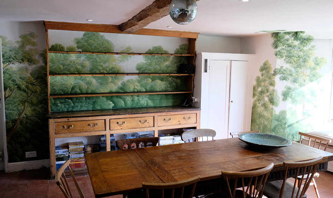 The Welsh dresser links to the window seat.