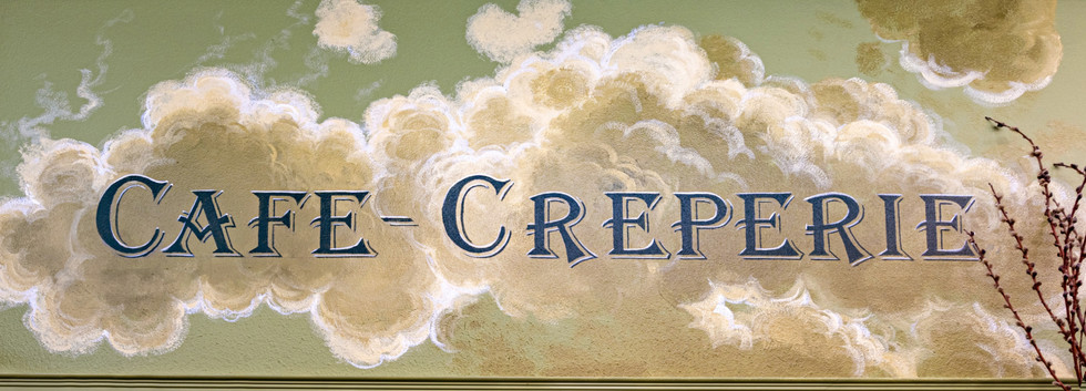 I painted all of the interior signs within back-lit cloud bursts.
