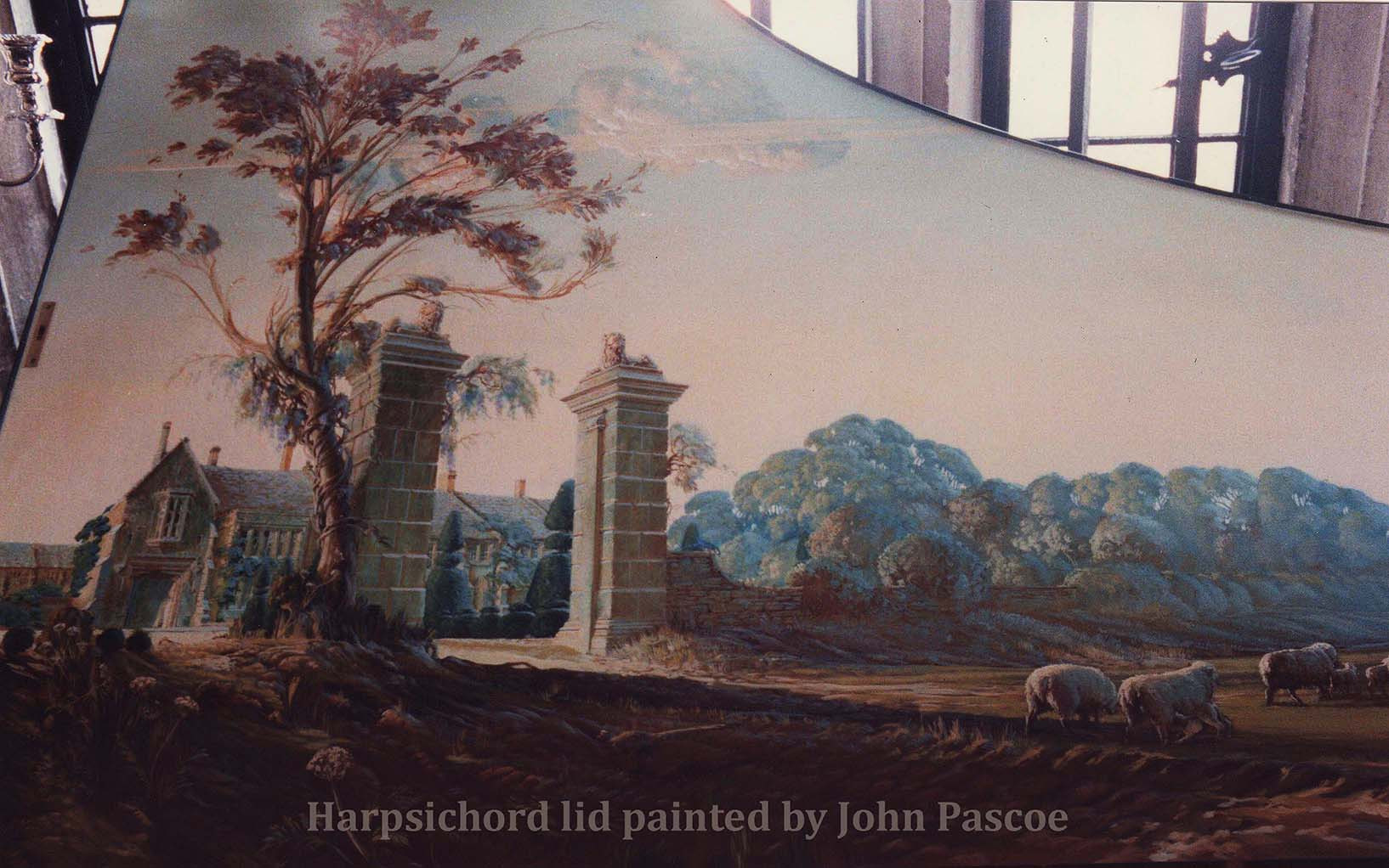 WRAXALL MANOR HARPSICHORD  I painted the interior of the lid with a view of the manor house,  as seen from massive entrance columns.  The lions on their caps were part of the heraldry of the manor.