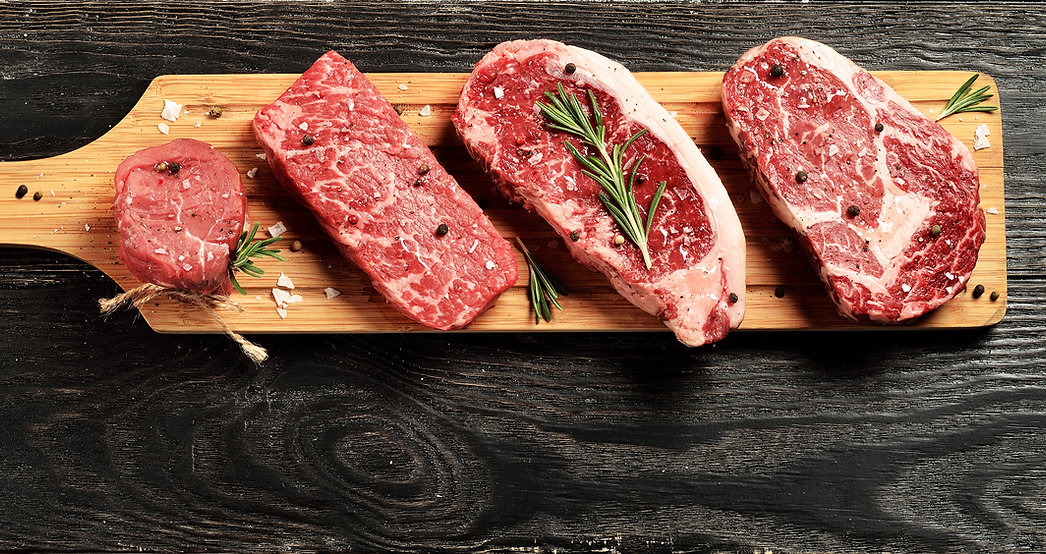 Fresh raw Prime Black Angus beef steaks on wooden board_ Tenderloin, Denver Cut, Striploin, Rib Eye
