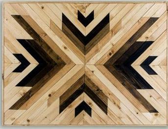 Cuadro tribal fabricado en madera.