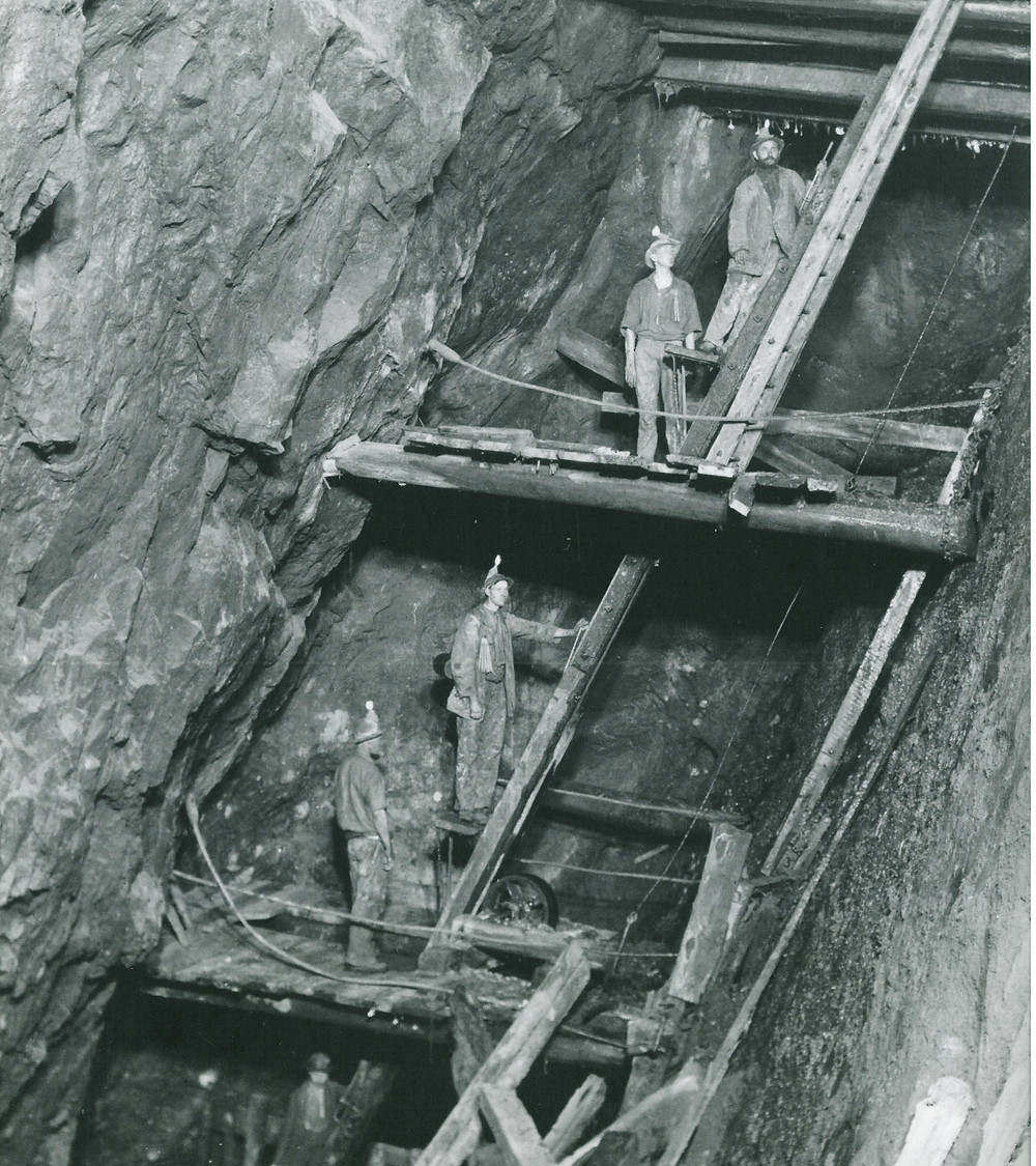 Miners at Dolcath Mine- using a basic form of lift to get from the bottom to the top of the mine.