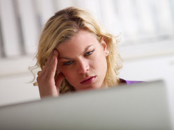 stockfresh_1772455_headache-and-health-problems-for-young-woman-at-work_sizeXS_eb257a