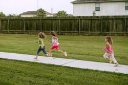stockfresh_316157_three-sister-girls-playing-running-on-the-park_sizeXS_5263c6