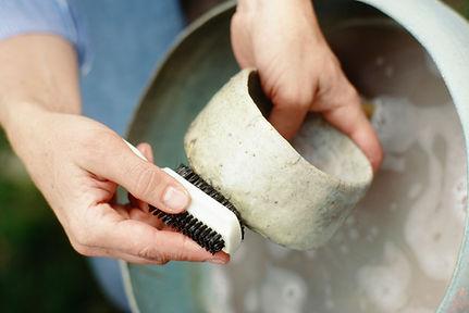 Potter handcrafting vessel