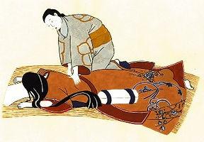 日本人があんまをしている。