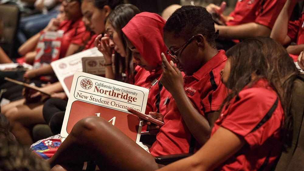 At freshman orientation at Cal State Northridge in August, students got information about the new wellness center, which offers acupuncture, massage therapy and drop-in yoga. (Ricardo DeAratanha / Los Angeles Times)