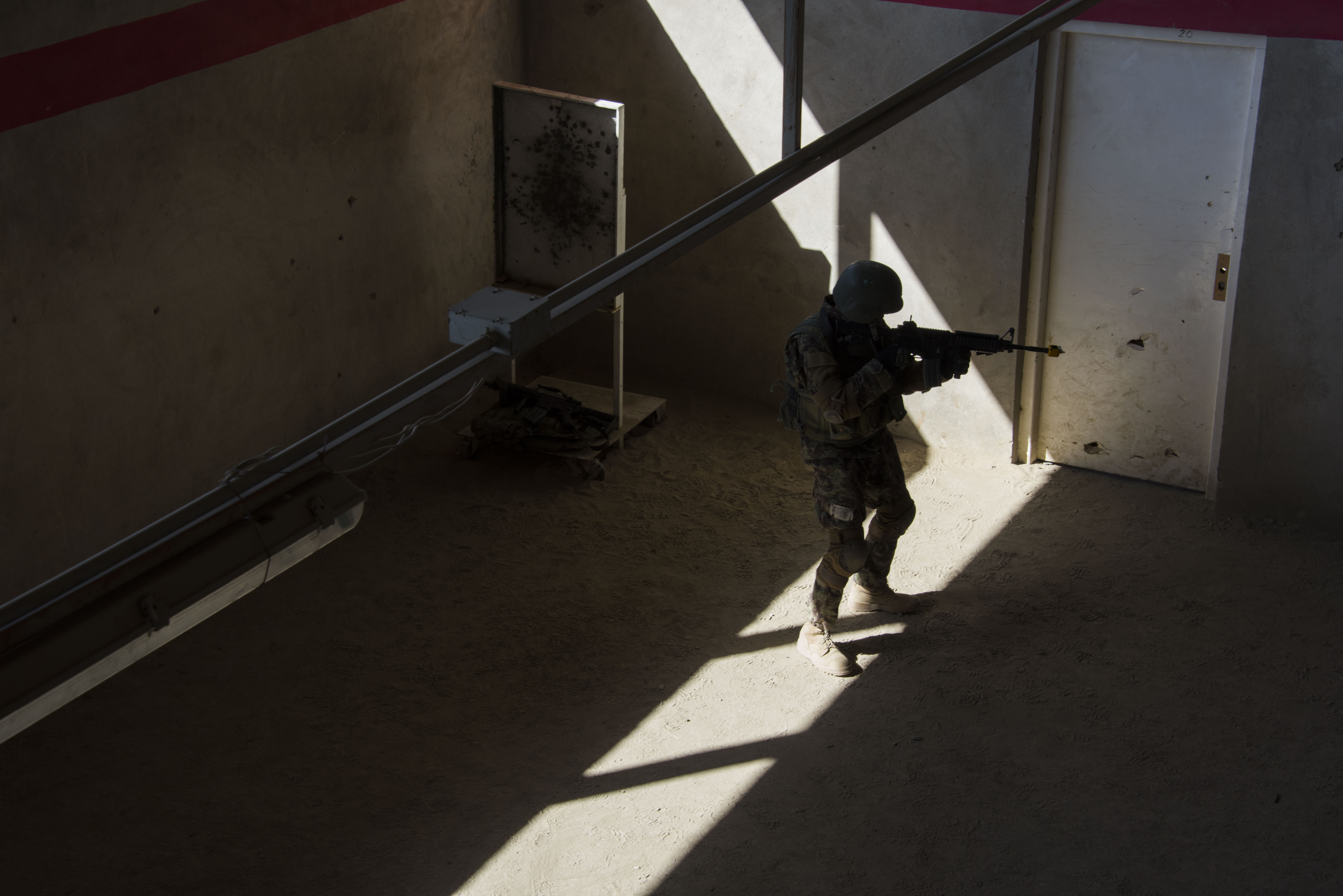 Portrait of a U.S. Marine at Camp Shorab in Helmand Province, Afghanistan by photojournalist and doc