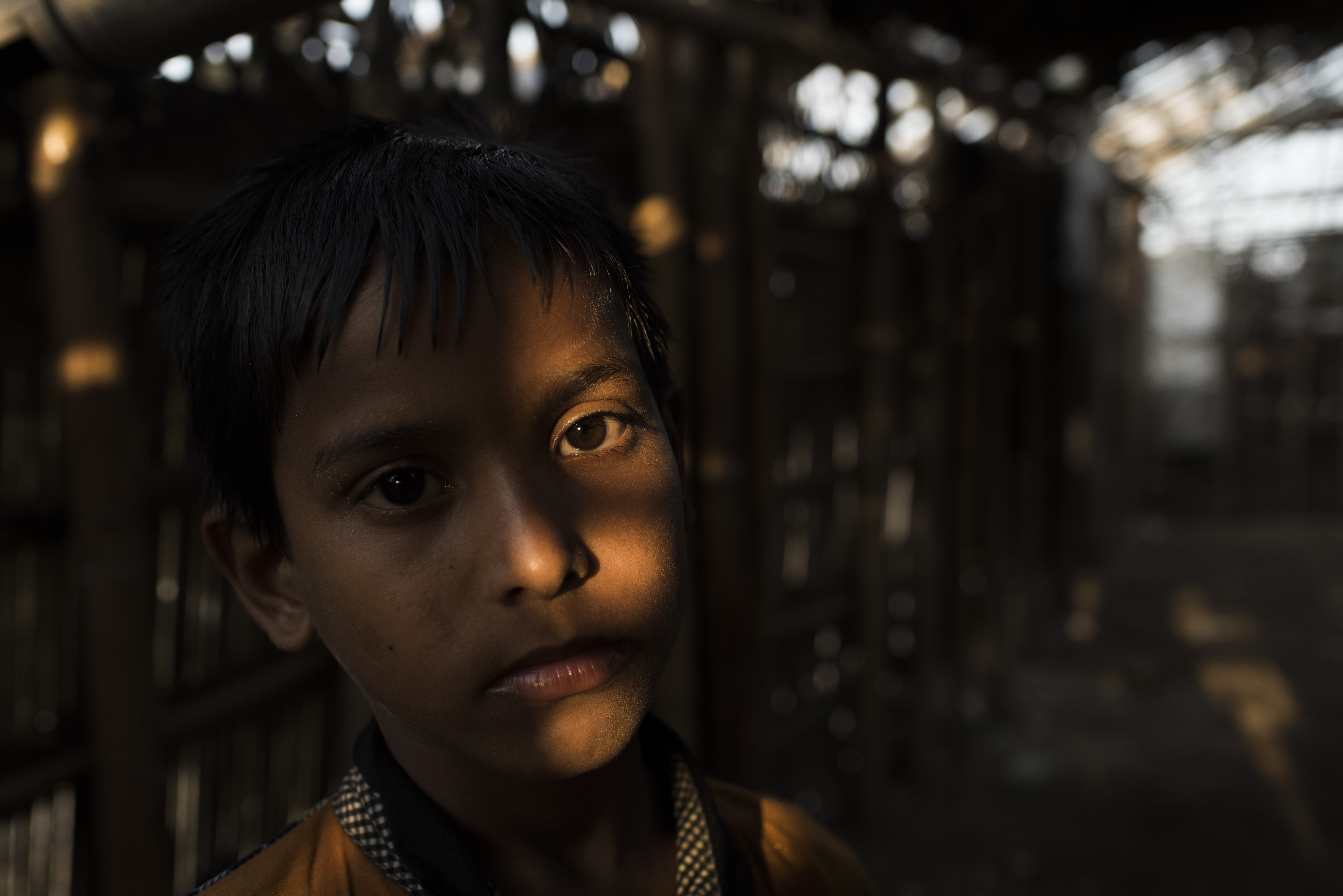 Portrait of a Rohingya boy in Kutupalong Refugee Camp outside of Cox's Bazar, Bangladesh by photojou