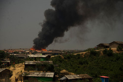 Fire in Kutupalong refugee camp outside of Cox's Bazar in Bangladesh, where Rohingya live in the lar