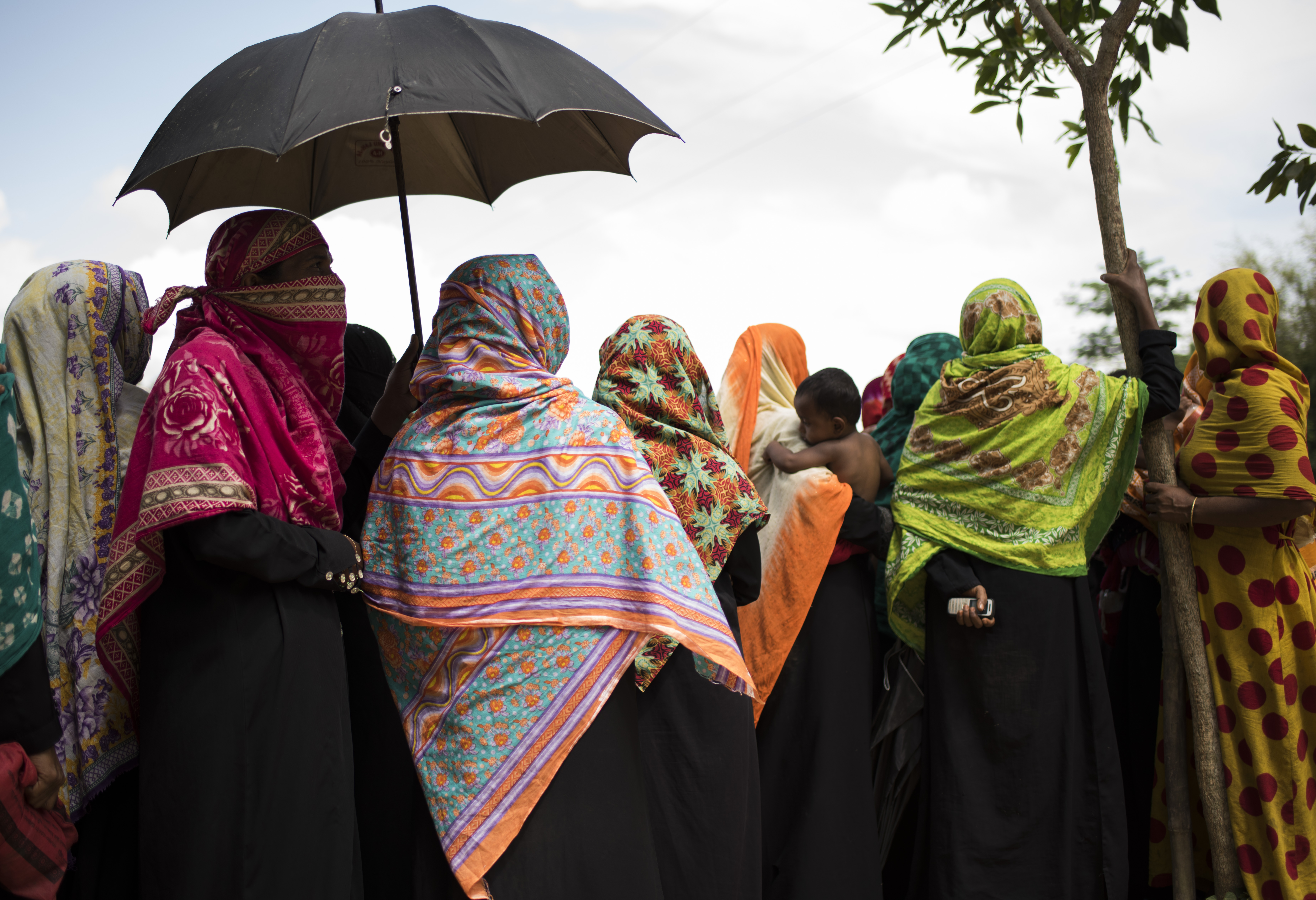 Rohingya women wait in a food distribution line in Kutupalong refugee camp outside of Cox's Bazar, B