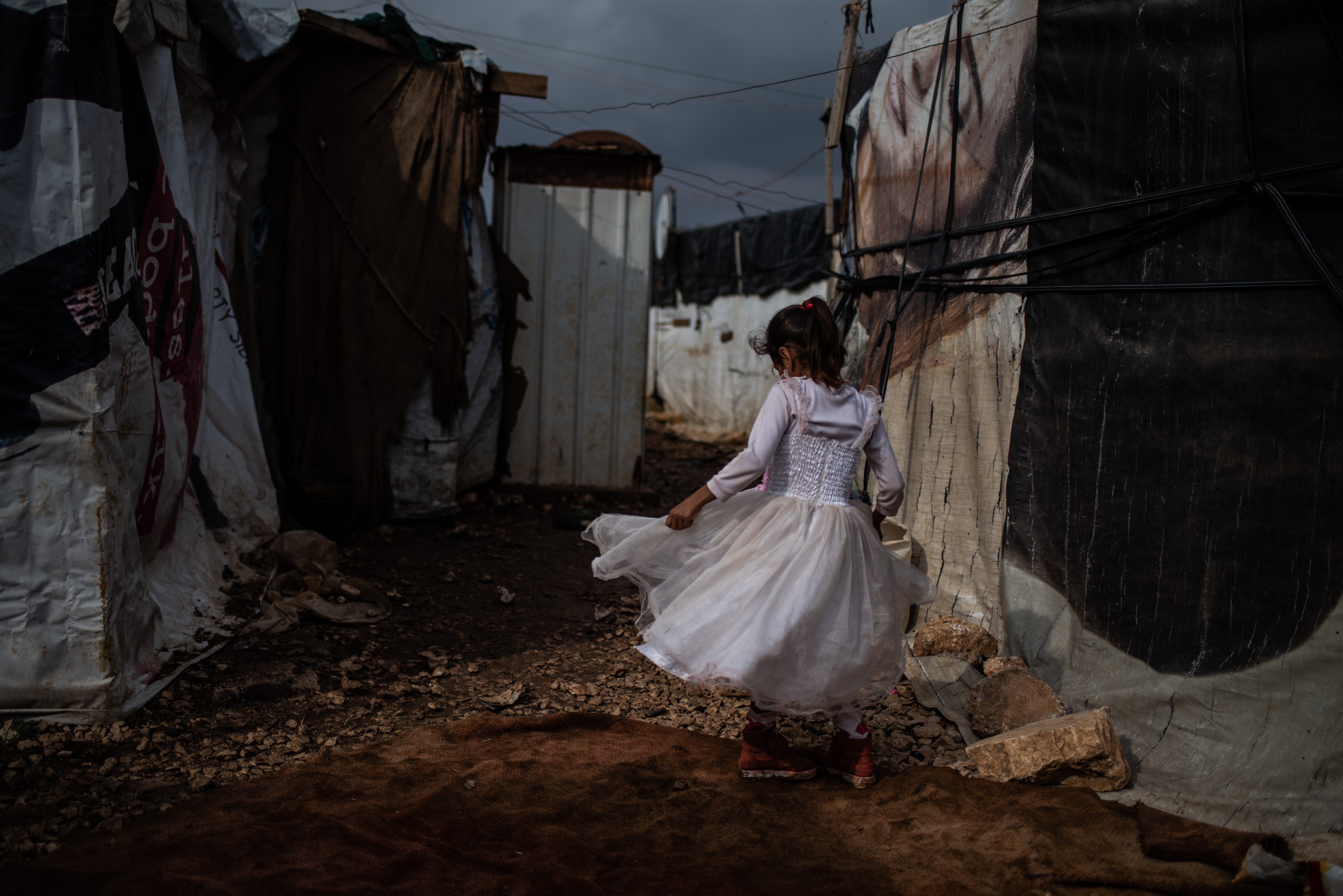 """""""Count to Two"""" - portrait of a young Syrian girl living as a refugee in an informal settlement in th"""