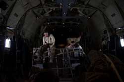 """""""The Longest Waiting Game"""" Portraits of U.S. Marines relaxing in a C-130 during a flight from Kabul,"""