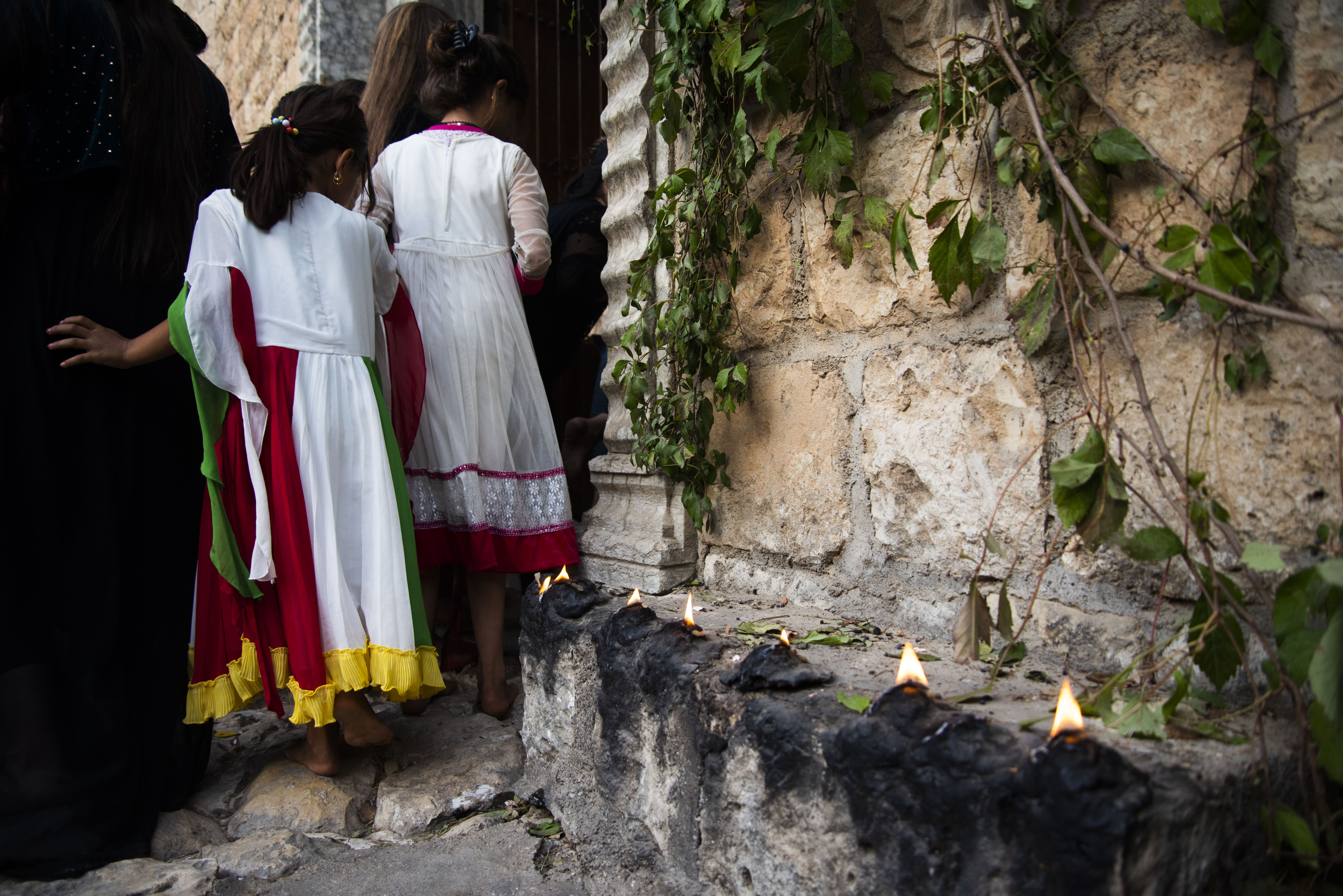 Young Yazidi girls in Lalish, the holiest site for the Yazidi community by photojournalist and docum