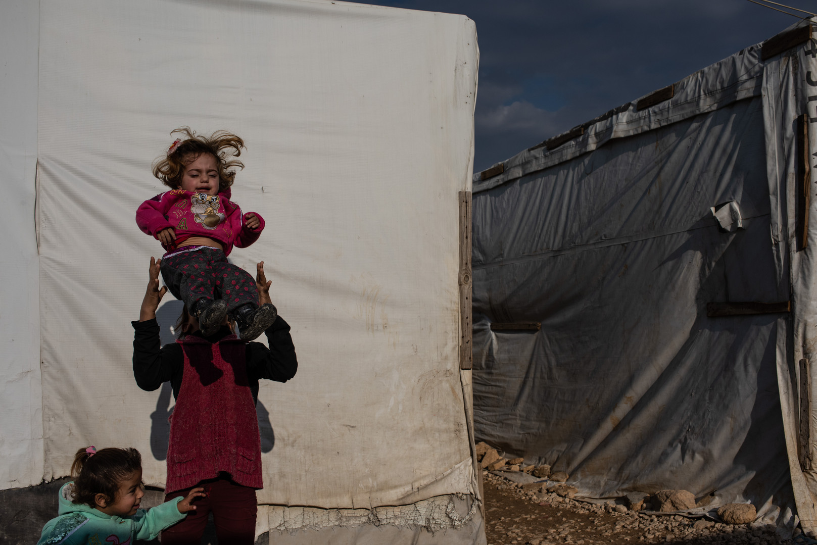 """""""Count to Two"""" - portrait of young Syrians living as a refugee in an informal settlement in the Beqaa Valley, Lebanon near the border of Syria by photojournalist and documentary photographer Hailey Sadler."""