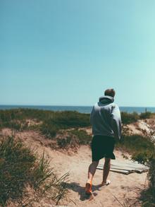 Man Running on a Beach