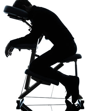 one man on chair massage in silhouette s