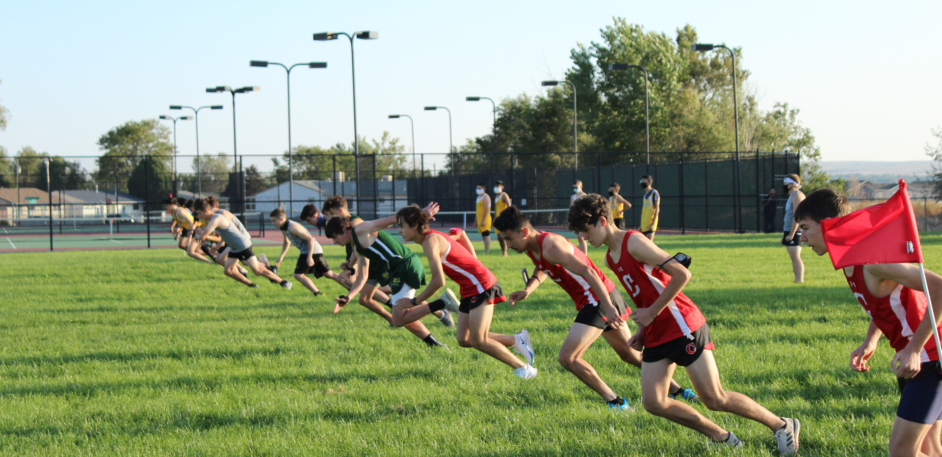 Runners in the first heat of the boy's r
