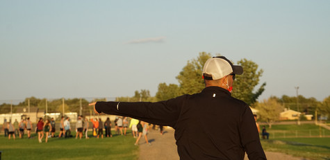 Coach, Ron Garcia, directs and motivates