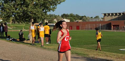Freshman, Sara DeHeart, strides through