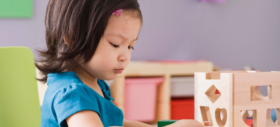 young girl playing in daycare