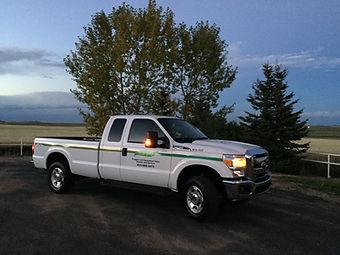 Service Truck in field.JPG