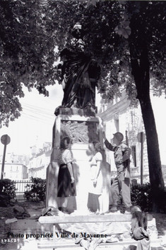1944 Place de Cheverus, Mayenne, American troops with locals at statue of Cardinal de Cheverus. The first Bishop of Boston USA.