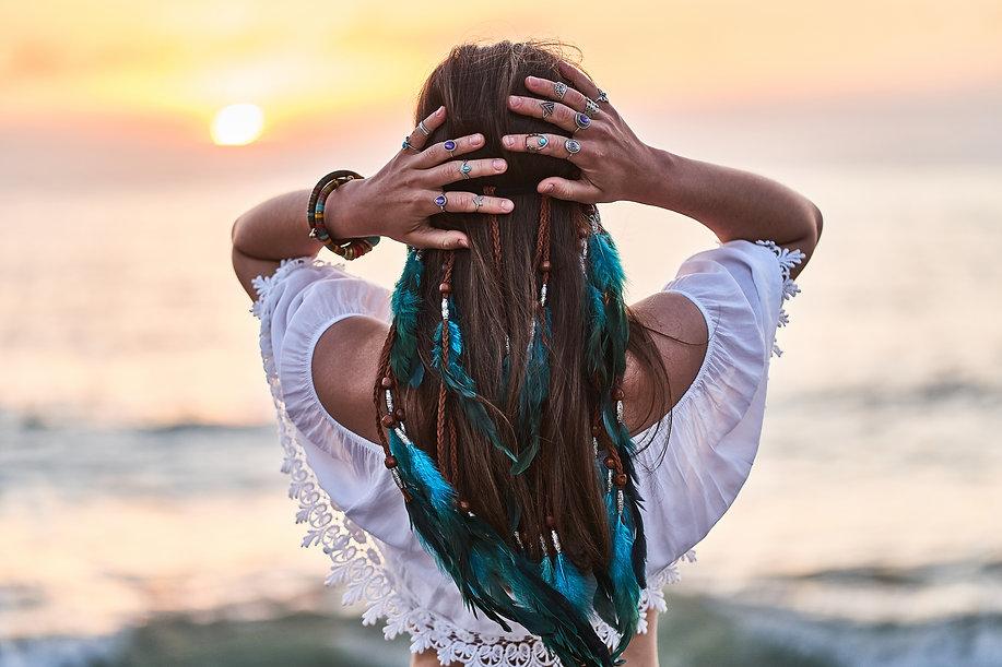 Hippie woman wearing blue feathers in lo