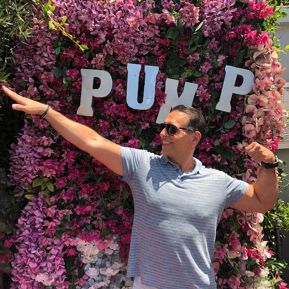 Reinvention King Gregory Cole, Empowerment and Wellness Guru, striking a bodybuilding pose at Pump restaurant, owned by #LisaVanderpump of #RHOBH