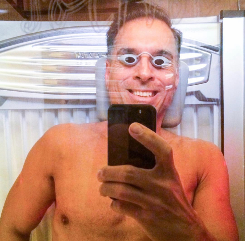 ReinventionKing Gregory Cole in tanning bed preparing for bodybuilding contest