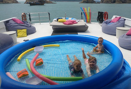 Deck pool with kids hky.jpg