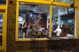 Customers in restaurant at night; old downtown Plano
