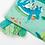 Thumbnail: Moulin Roty grand livre tissu d'activités Sous mon baobab