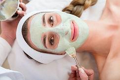 Canva - Smiling Woman Getting Facial Tre