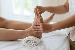 Canva - Asian girl relaxing having feet