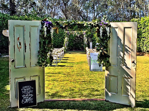 Vintage door arbour with life like foliage and blooms