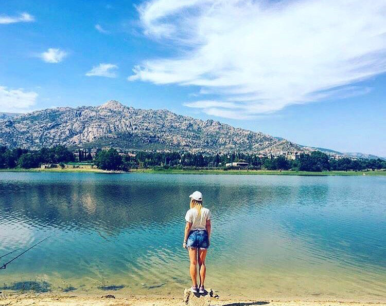anna standing in front of a lake