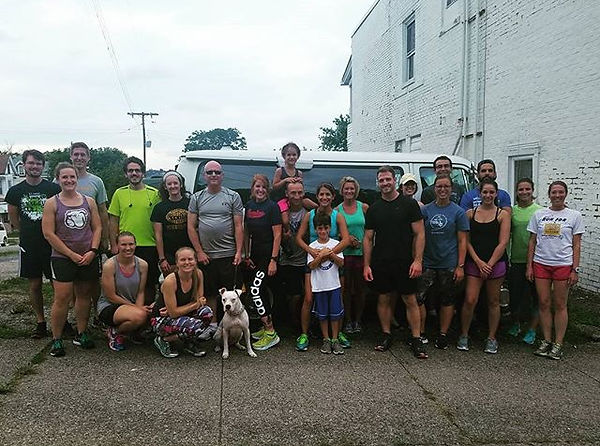 Group photo of We Run! Morgantown runners after a Joggers event.