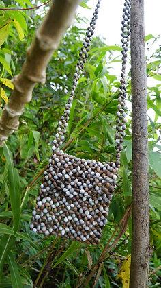 Bolso en semillas de moisés