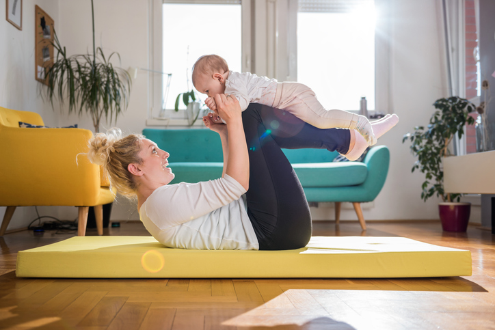 mom exercise with kid