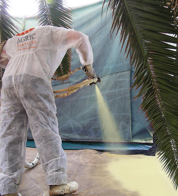 Construction Worker Uses PU Spray-On