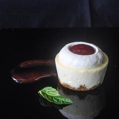 Vanilla bean cheesecake with basil ganache and strawberry