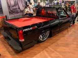 custom black truck lowrider wrap + rims.