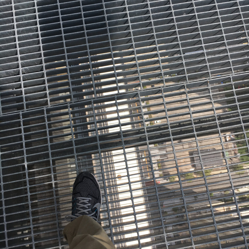 Gazing 71 floors down through the grate atop Jersey City Urby building