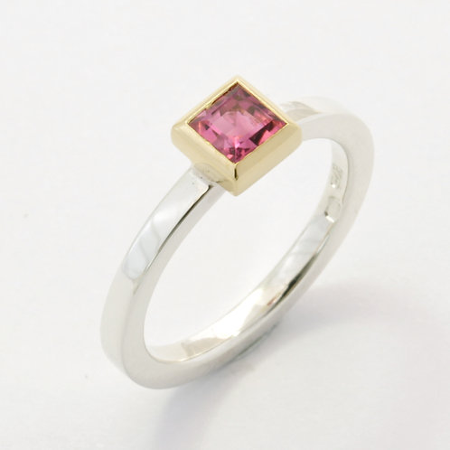Silver ring with pink tourmaline in 18ct yellow gold