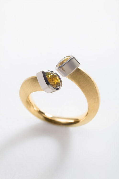 18ct yellow gold engagement ring with pear cut yellow sapphires