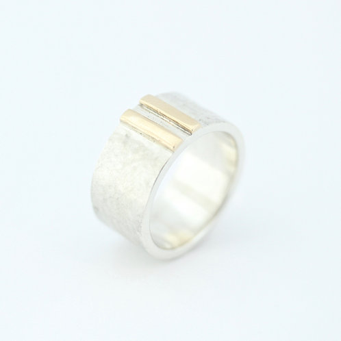 Wide silver and gold ring