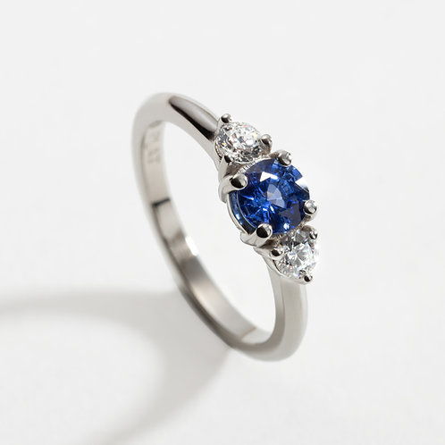 Platinum Ring with Sapphire and Diamond